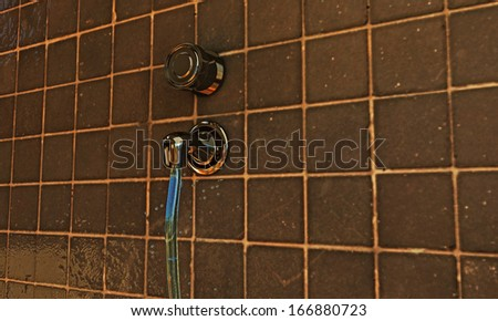 illustration of an open faucet with falling water - stock photo
