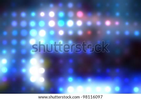 illustration of blurred neon disco light dots pattern on dark background - stock photo