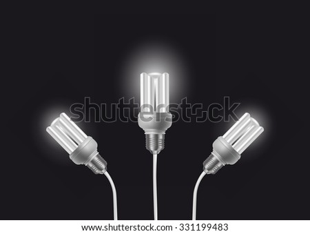 Illustration of energy saving light bulbs with cords on dark background - stock photo