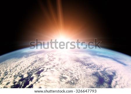 Illustration of Rising Sun over Earth horizon - stock photo