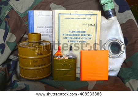 ILLUSTRATIVE EDITIRIAL.Vintage Soviet chemical and nuclear warfare protection items.Secret military literature of 1960-th. At April 19,2016 in Kiev, Ukraine - stock photo