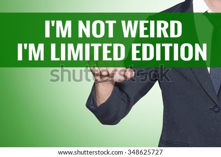 Im Not Weird Im Limited Edition word Business man point on green tab virtual screen - stock photo