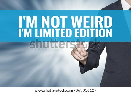 Im Not Weird Im Limited Edition word on virtual screen touch by business woman cyan sky tab - stock photo