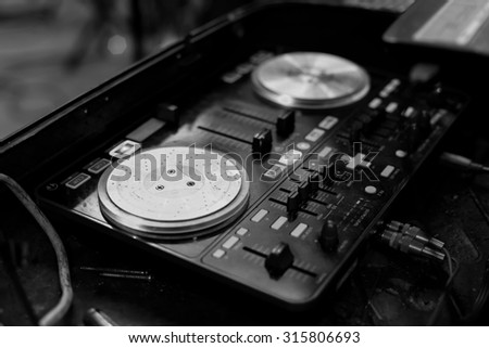 Image black and white of turntable at Nightclub party - stock photo