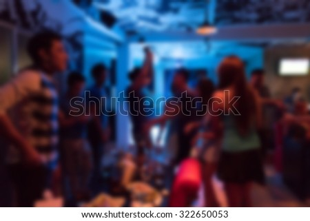 image blurred background, group of young people having joyful dancing in nightclub party - stock photo
