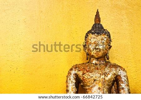 Image buddha on yellow wall - stock photo