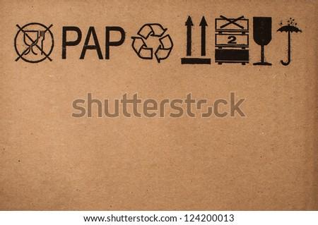 Image close-up of grunge black fragile symbol on textured cardboard - stock photo