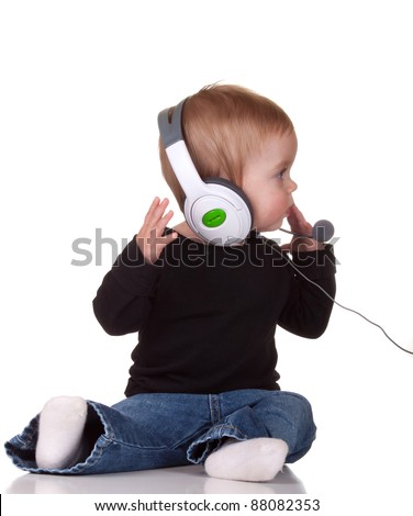 Image of a baby wearing a head set. - stock photo