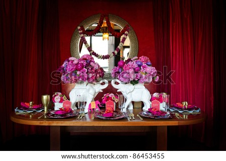 Image of a beautiful table setting for an Indian weding - stock photo