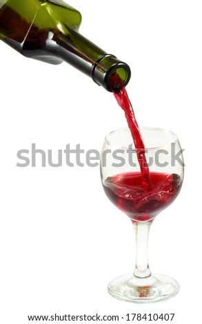 image of a bottle with wine and a wineglass on a white - stock photo