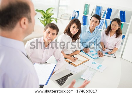 Image of a business briefing with the boss at the office  - stock photo