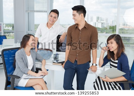 Image of a business command sharing new ideas at the office - stock photo