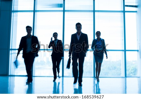 Image of a business team in a motion inside - stock photo