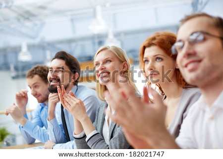Image of a business team with its leader being at the conference on the foreground  - stock photo