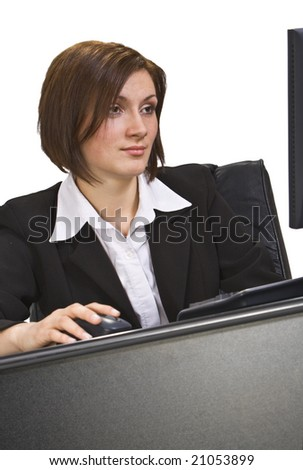 Image of a businesswoman usin a computer at her pffice desk-interesting perspective. - stock photo