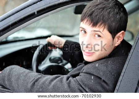 Image of a confident young businessman in his car - stock photo