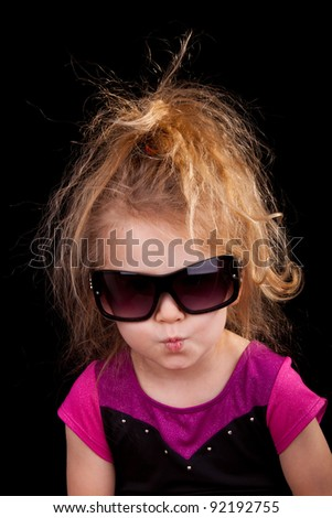 Image of a cool little girl with sunglasses. - stock photo