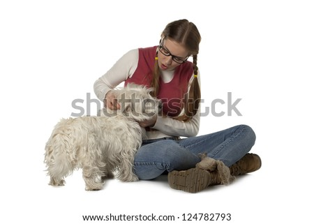 Image of a cute teenager playing her white maltese dog - stock photo