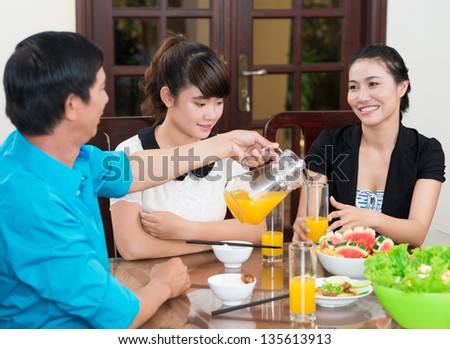 Image of a family sitting at the family dinner - stock photo