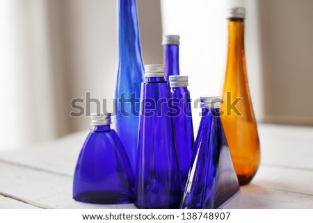Image of a few different bottles on the table - stock photo