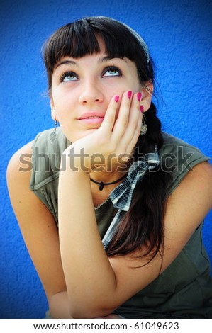 Image of a girl daydreaming - stock photo