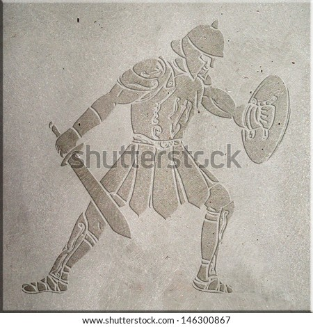 Image of a gladiator carved on concrete wall - stock photo