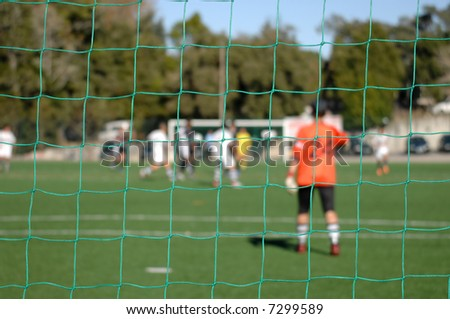 Image of a goalkeeper whatching the game, focus the net - stock photo