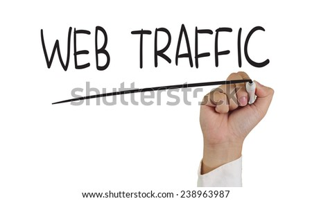 Image of a hand holding marker and write Web Traffic isolated on white - stock photo