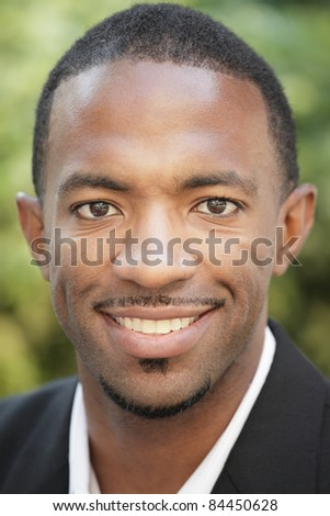 Image of a handsome black man smiling - stock photo