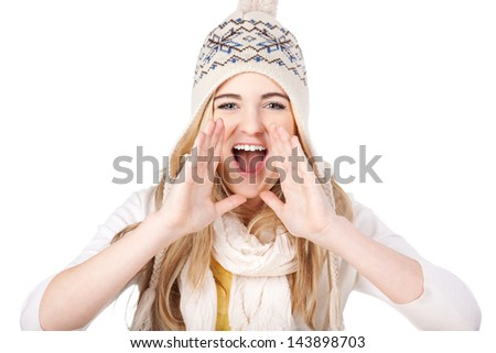 Image of a happy teenage girl shouting wearing warm clothes, isolated on white background. - stock photo