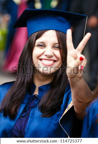 Image of a happy young graduate - outdoor shot - stock photo