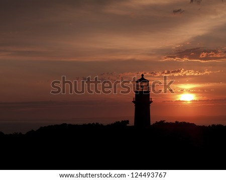 Image of a lighthouse at sundown. - stock photo