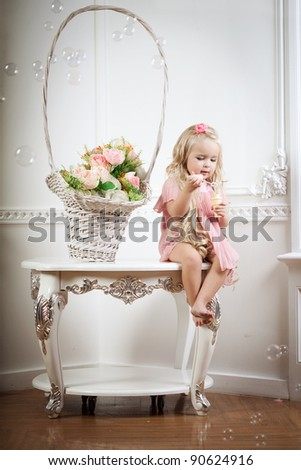 Image of a little girl in a fashionable luxury interior - stock photo