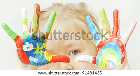 image of a little girl with hands painted. See my portfolio for more - stock photo