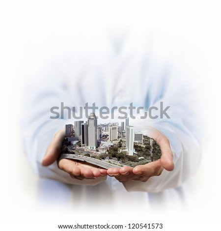 Image of a modern cityscape in the hand of a businessman - stock photo