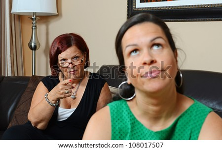 Image of a mother looking upset at her daughter - stock photo