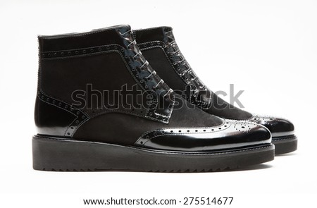 Image of a pair of black leather boots - stock photo