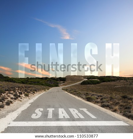 Image of a road with white arrow and finish sign - stock photo