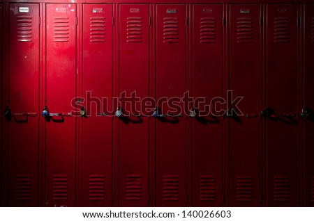 Image of a row of lockers with dramatic lighting - stock photo