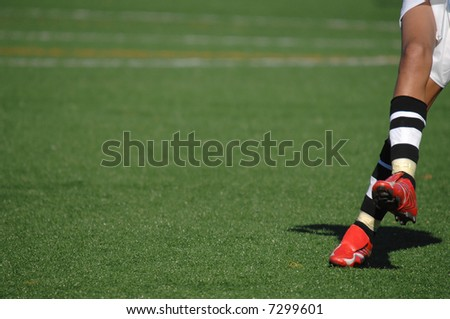 Image of a soccer player after kicking the ball - stock photo