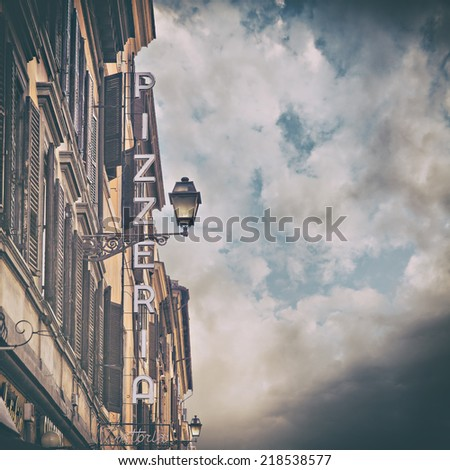 Image of a traditional pizzeria trattoria sign. Rome, Italy. Some added noise.  - stock photo