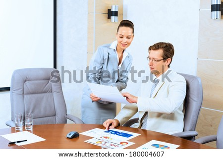 image of a two businessmen discussing documents, teamwork - stock photo