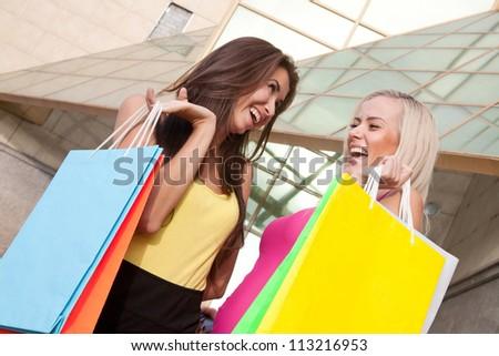 Image of a two young women with shopping bags - stock photo