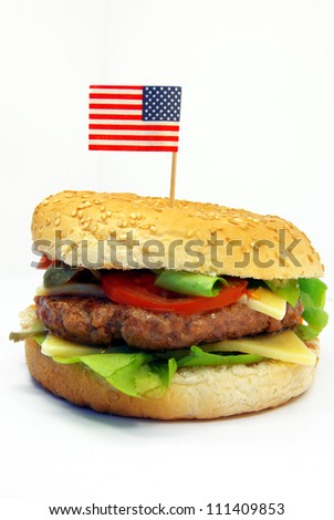 Image of a typical hamburger with American flag - stock photo