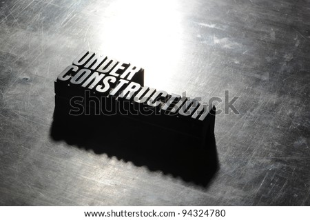 Image of a Under Construction sign with a metallic background texture - stock photo