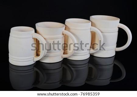 Image of a wooden beer mug on black background - stock photo