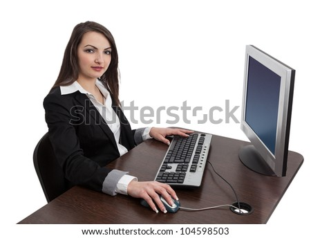 Image of a young brunette woman working on a computer while looking to the camera, isolated against a white background. - stock photo