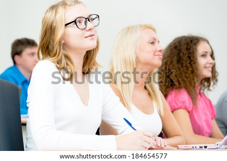 image of a young female students in the classroom, teaching at the University of - stock photo