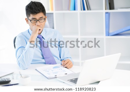 Image of a young sales manager worrying about risky strategic movement - stock photo