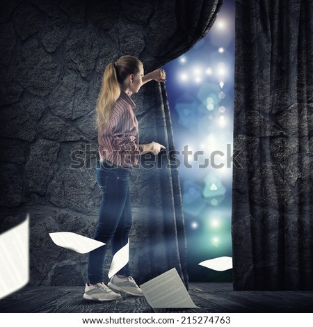 image of a young woman bends curtain fly sheets - stock photo